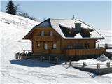 Slovenske planine v vseh letnih časihNad jezercem, bolje rečeno poletno mlako je ta novogradnja.