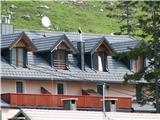 Slovenske planine v vseh letnih časihTretji po vrsti so apartmaji Škerjanc.